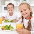 Kids eating a healthy meal - Stock Photo