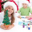 Siblings with lots of presents at christmas time — Stockfoto