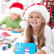 Foto Stock: Siblings with lots of presents at christmas time
