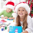 Siblings with lots of presents at christmas time — Stockfoto #7539115