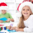 Siblings with lots of presents at christmas time — Stock Photo #7539123