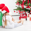 Siblings with lots of presents at christmas time — ストック写真