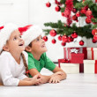 Siblings with lots of presents at christmas time — Stock Photo #7539140