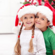 Siblings with lots of presents at christmas time — Stock Photo #7539150