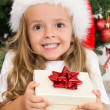 Ecstatic happy girl with christmas present — Stockfoto