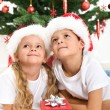 Smiling kids at christmas — Stock Photo