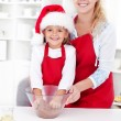 Famili moments - preparing the christmas cookie dough - Stock Photo