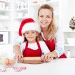 Stretching the christmas cookies dough — Stock Photo
