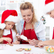 Family decorating christmas cookies — Stock Photo