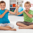 Boys showing their biceps — Stock Photo