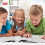 Kids having fun reading — Stock Photo