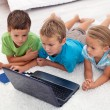 Kids looking at laptop computer — Stock Photo