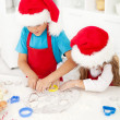 Kids making christmas cookies — Stock Photo #7539833