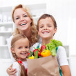 Happy family with the groceries — Stock Photo #7539844