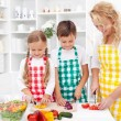Stock Photo: Family preparing fresh salad