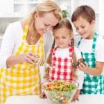 Seasoning the fresh vegetables salad — Stock Photo