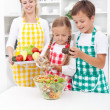Kids preparing a healthy fresh salad — Stock Photo
