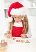 Little girl with christmas cookies — Stock Photo