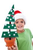 Happy kid holding christmas decoration — Stock fotografie