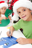 Making and writing christmas greeting cards — Stock Photo