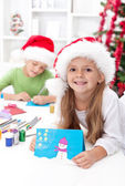 Siblings with lots of presents at christmas time — Stock Photo