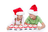 Mischievous christmas kids — Stock Photo