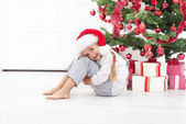 Happy little girl under the christmas tree — Stock Photo