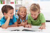Kids having fun reading — Stock Photo