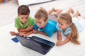 Kids looking at laptop computer — Stock Photo