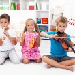 Kids playing on musical instruments — Stock Photo #7563331