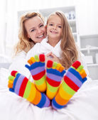 Happy girl and woman at home — Stock Photo