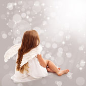Little angel thinking in divine light — Stock Photo