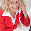 Stock Photo: Happy business woman on the phone