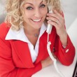 Happy business woman on the phone — Stock Photo