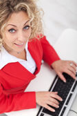 Smiling woman in the office — Stock Photo