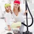 Cleaning day - womand little girl with vacuum cleaner — Stock Photo #7941362