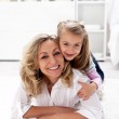 Happy times - little girl with her mother — Stock Photo