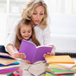 Reading a book with mom — Stock Photo