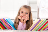 Little girl discovering the world of books — Stock Photo