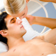 Young attractive happy amorous couple in bedroom — Stock Photo