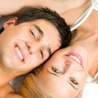 Portrait of young happy amorous couple at bedroom — ストック写真