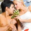 Young happy couple celebrating with champagne at bedroom — Stock Photo #6764073