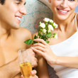 Royalty-Free Stock Photo: Young happy couple celebrating with champagne at bedroom
