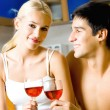 Young couple celebrating with red wine at home — Stock Photo #6764242