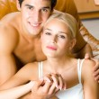 Foto de Stock  : Portrait of young happy amorous embracing couple at home
