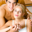 Foto Stock: Portrait of young happy amorous embracing couple at home