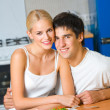 Young happy amorous couple at domestic kitchen — Stock Photo #6764548