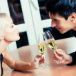 Couple on romantic date or celebrating together at restaurant — Stok fotoğraf