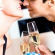 Kissing couple on romantic date or celebrating together at resta — Stok fotoğraf