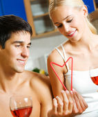 Couple celebrating with red wine and self-made heart symbol made — Stock Photo